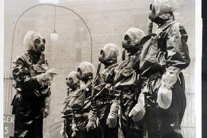Police officers in gas masks receive anti-gas instruction at Lancaster Castle, used as an anti-gas training school by the Lancashire Constabulary in December 1936.