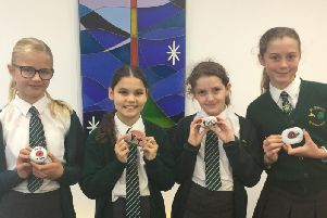 Some of the St Patrick's RC School year six pupils with their decorated stones