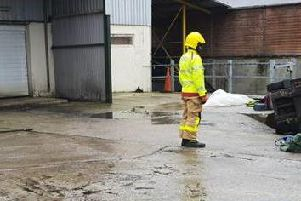 Firefighters at the scene of the forklift truck accident at Staveley's Eggs