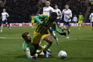 Preston goalkeeper Declan Rudd is adjudged to have fouled West Bromwich Albion substitute Kyle Edwards