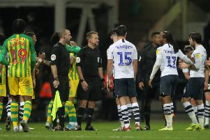 Preston players make their feelings known to referee Oliver Langford after the final whistle against West Bromwich Albion