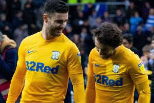 Andrew Hughes shares a joke with Ben Pearson before Preston's game against Queens Park Rangers last Saturday