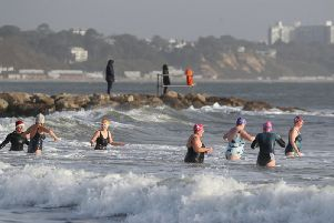 Member of the Beyond the Blue swimming group in the sea at Sandbanks Beach in Dorset, as they take part in a Christmas eve swim