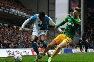 Blackburn Rovers' Ryan Nyambe tries to find a way past Preston North End's Paul Gallagher