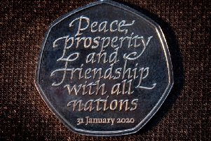 The new Brexit coin, a 50p bearing the inscription 'Peace, prosperity and friendship with all nations' and the date the UK leaves the EU.