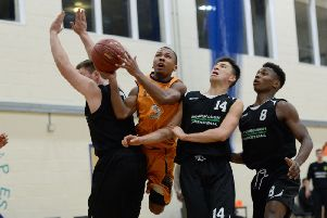 Jonny Joseph of Preston's College tries to get a shot off over a trio of Myerscough College Giants players