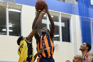 Melkisidek Moreaux reacts first to the rebound against Leeds Tigers