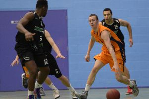 Daniel Miller tries to outwit Myerscough's defenders