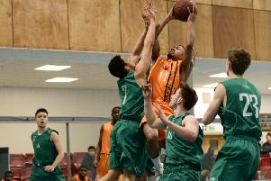 Jonathan Joseph takes a tough shot over Ky Elly of Myerscough