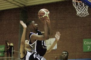 Kyle Carey locks in the basket during the Hoopsfix All-Star Classic (photo: Mansoor Ahmed)