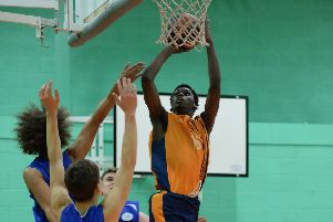 Sheik Sheriff beats three defenders to score a basket during Preston's game against Sefton Stars (Photo: Mansoor Ahmed)