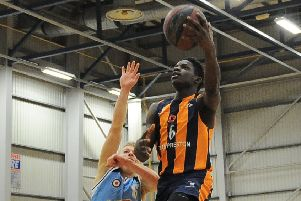 Moses Byekwaso drives past a Manchester Magic defender (photo: Mansoor Ahmed)