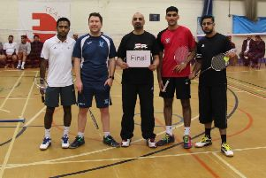 Competition organiser Mohammed Kabir Sharif with the finalists
