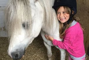Isabella Dawson with her rescue pony Norman