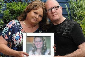 Sheila and Trevor Fairhurst with a picture of Carly