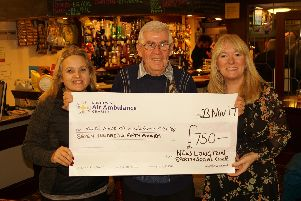 Sharon Taplin, Keith Winder from  New Longton Sports and Social Club and Lynne Whittaker, from NWAAS