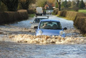 A driver braved the floods on Longmoor Lane near Garstang and subsequently got stuck. Photo: Neil Cross.
