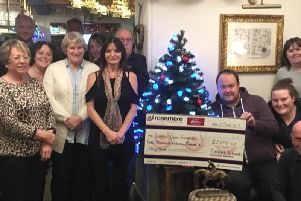 Terry Trelfa, Simon Hunter, Chris Warton, Rob Coirrigan, Linda Hall, Helen Quinn, Margaret Corrigan, Julie Simmons and Brenda Trelfa. Right of the tree are Andy and Steph Hardman with the cheque for Rosemere, Shelley and Andy Dawes and Neil Bamford