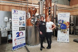 Copa Fizzs Gillian Bartlett (left) and Rosemere Cancer Foundations central area fundraising co-ordinator Rebecca Hall by a vat of the Copa Fizz Rosemere Gin