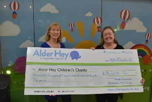 Shaw Hills Lady Captain for 2017, Alison Davidson, hands over a cheque to Alder Hey Childrens Hospital for 16,405