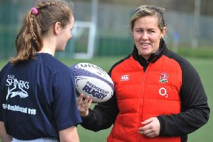 Marlie Packer with one of the young rugby players