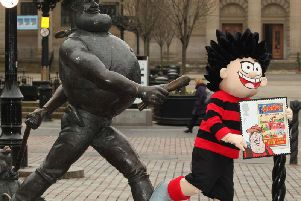 Dennis the Menace and Desperate Dan in their 'home town', Dundee'Photo: PA