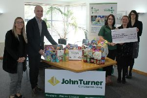 Staff from John Turner Construction with Trussell Trust representatives