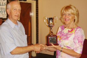 Barbara Taylor presens the award to Ralph Cooper, secretary of Newman College FC