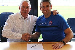 Manager Dave Challinor (right) signs his new contract with AFC Fylde owner David Haythornthwaite    Picture: AFC Fylde