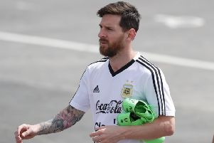 Lionel Messi arrives for a training session ahead of Argentina's game against Nigeria
