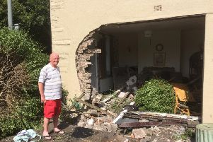 Tony Ross surveys the damage to his destroyed home after a car crashed into it.