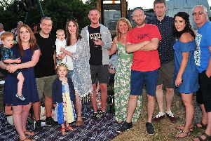 Family and friends gather at the beer and music festival