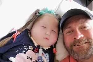 Aerospace worker Paul Fisher, 49, from Leyland with his four-year-old granddaughter Millie, who has a rare genetic condition