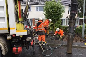 Engineers work on clearing the water from gas pipes