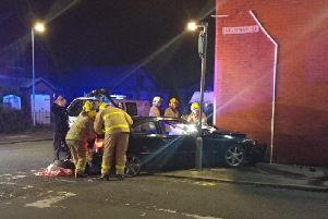 Emergency services were called when the car crashed into the wall of a house.