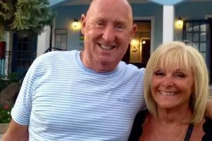 Family and friends said an emotional farewell to Burnley couple John and Susan Cooper at their funeral today.