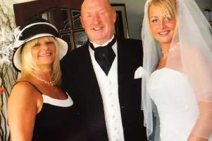 Kelly Ormerod is pictured on her wedding day with her proud parents, John and Susan Cooper, who died on their family holiday to Egypt in August.