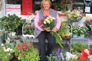 Sara Barrow outside her shop 'Flowers With Passion'.