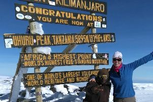 Paula Holt-Rogers, of Eccleston, and one of the guides at the summit of Mount Kilimanjaro, raising funds for Parkinson's UK