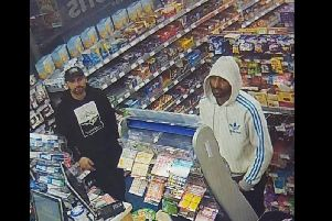 The two men wanted by police.