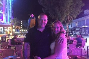 Martin and Lindsey Brown of Chorley posing with a parrot on holiday