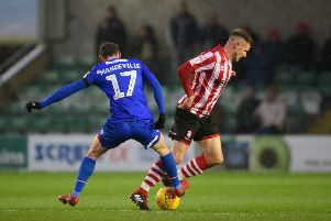 Morecambe's Liam Mandeville battles for possession with Lincoln City's Michael O'Connor during last weekend's League Two clash