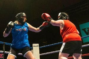 Laura Brookes (in blue) takes part in a boxing match