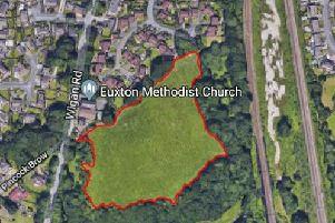The homes are earmarked for the plot of land outlined in red
