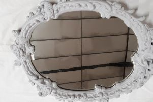 This grey decorative mirror is on sale for 35 pounds