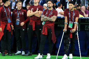 Liverpool's Alex Oxlade-Chamberlain (right) on crutches due to a knee injury during the UEFA Champions League Final at the NSK Olimpiyskiy Stadium