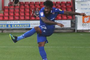 Jordan Cranston saw his penalty saved but then created Morecambe's second goal with a cross for Steve Old