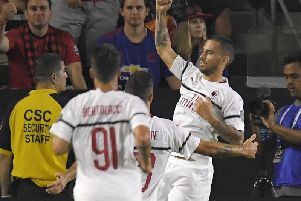 AC Milan forward Suso, right, celebrates his goal with teammates during the first half of an International Champions Cup tournament soccer match against the Manchester United.
