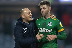 Paul Gallagher celebrates the win at QPR with PNE boss Alex Neil