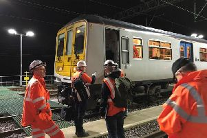 Engineers making final tests on the new Preston to Manchester route